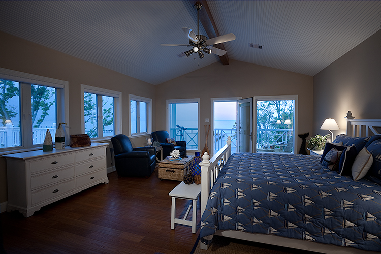 Interior photograph of guest bedroom at bay house with view of bay