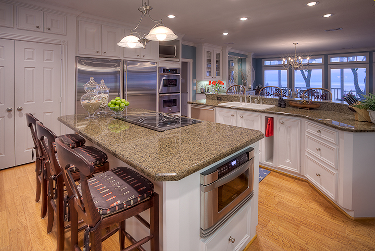 Interior architectural photograph of custom kitchen in bay home looking out to bay