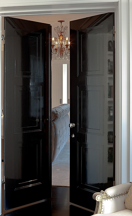 Architectural photographic detail og black laquer master bedroom bifold doors