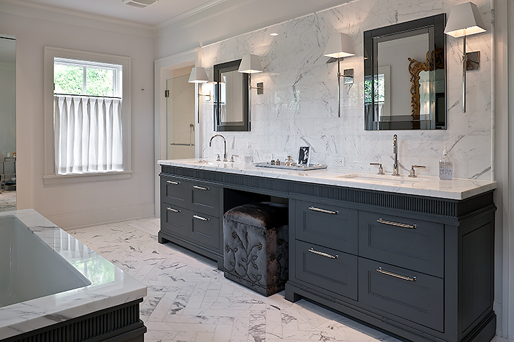 architectural photographic detail of a master bath vanitywith white marble floor, counter top, tub suround and wall surface